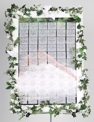 celebration seating board helps organize name tag holders for tables at wedding reception