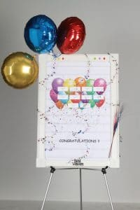 event hosting party balloons congratulations on name badge display board