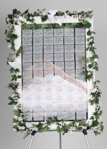 name badge display board decorated as wedding celebration board with transparent name tags showing bride in dress