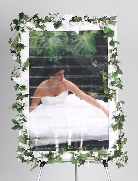 decorated celebration seating board with bride in dress no name tags on celebration board