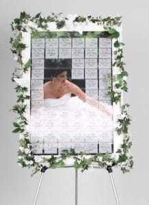 wedding seating chart display ideas reveal picture of bride behind name tags